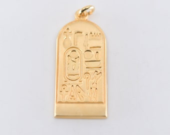 hieroglyphic style pendant vintage revival style costume fantasy jewellery charm high polish gold tone metal marked m oblong unusual c1990s