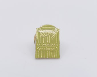 pin French vintage cacharel la chemiserie fashion clothing label green gold badge designer collection advertising memorabilia signed winner