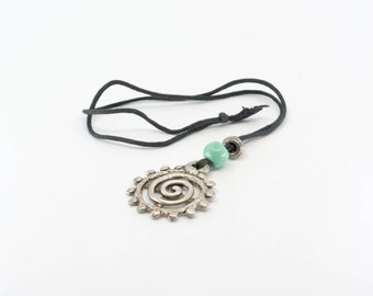 spiral pendant silver tone metal stamped PARIS single strand black string turquoise coloured bead detail French vintage jewellery 1970s