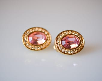 vintage earrings clip-on designer costume jewellery pink faceted rhinestone strass and gold tone metal oval clip ons 1980s