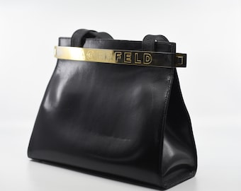 Vintage LAGERFELD black handbag top handle shoulder length leather gold metal clasp tote style collectible designer KL made in Italy c.1980s