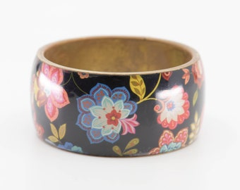 vintage cuff bangle wide chunky brass jewellery for wrist colourful floral bracelet pattern on black background polished finish French