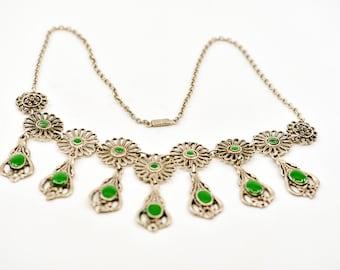 bib necklace vintage silver green cabochon floral teardrop tiered drop arrangement ornate costume statement jewellery necklace MCM 60s rare