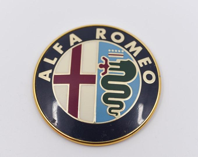 Featured listing image: ALFA ROMEO badge cap vintage car part plastic accessory bomiso milano 2400 51016 logo advertising Italian classic car collectible revival