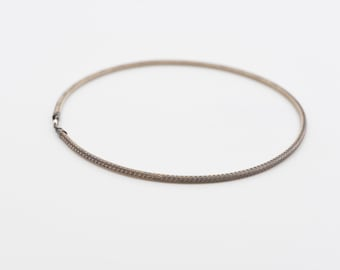 silver choker necklace braided woven metal single strand ras de cou argent jewellery designer Folli Follie 925 hallmark made in Greece 1990s