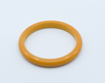 bakelite bangle matt orange vintage slim spacer bracelet tested midcentury early plastic collectible midcentury jewellery French 1950s rare