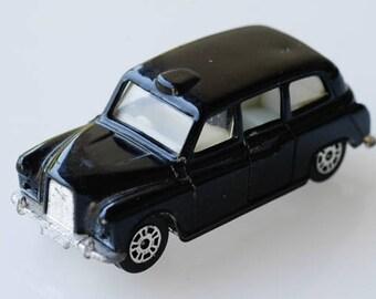 toy car london black taxi cab CORGI junior made in Great Britain transport collectible memorabilia die cast model miniature push toy 1984