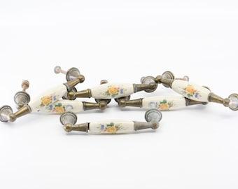 brass porcelain pulls French vintage dresser cabinet handles metal salvage hardware for furniture restoration floral motif country home deco