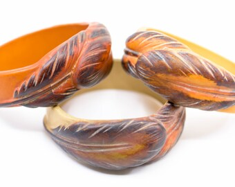 french vintage bangles three bracelets orange ecru yellow carved lead motif in relief solid resin unusual wide chunky statement jewellery