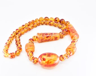 midcentury faux amber confetti long necklace chunky single strand bead graduated French vintage lucite early plastic statement jewelery rare