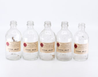 apothecary bottle vintage clear glass pharmacy glassware French italic label glycérine anglaise window display soap making midcentury decor