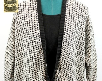 25e8794fed2 Black and White cotton blend knit sweater with open front and winged sleeves.  By Ann Taylor Loft