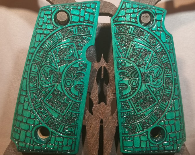 Kimber Micro 380 with engraved AZTEC calendar and stone wall