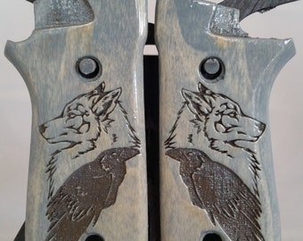 Taurus PT99 with Decock Grips with RAVEN and WOLF engraving