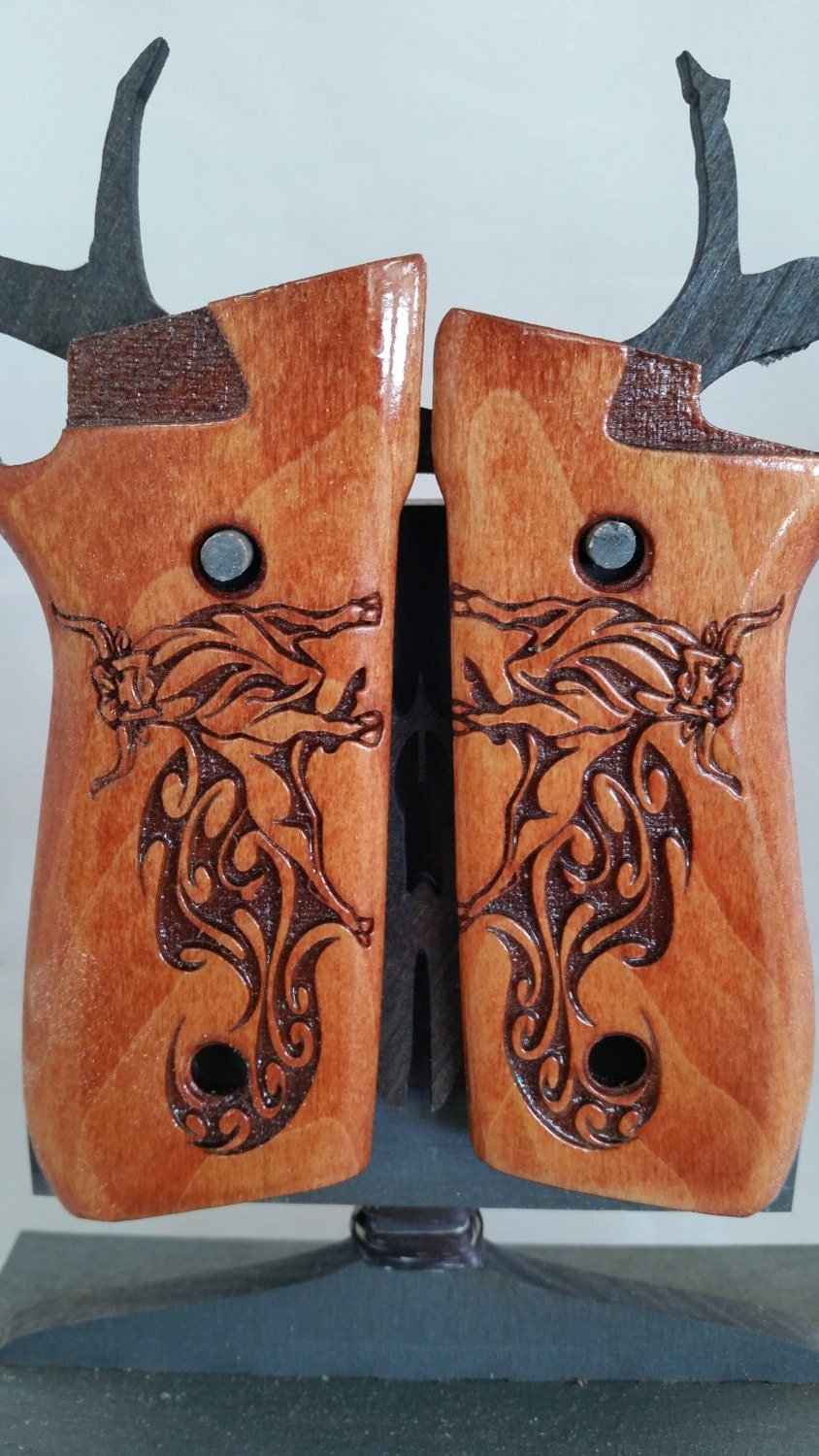 Taurus PT92 with Decock Grips with Raging Tribal Taurus