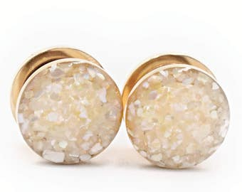 Pearl Crushed Shell shown on Gold Plugs / 16g, 10g, 8g, 6g, 4g, 2g, 0g, 00g, 7/16, 1/2, 9/16, 5/8, 11/16, 3/4in, 7/8in, and 1 inch