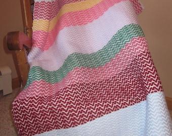 multicolored handwoven lap blanket