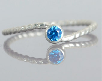 Wave Ring, Silver Wave Ring, Blue Zircon Mothers Ring, December Birthstone Ring, Silver Twist Ring, Unique Mother's Ring, Blue Zircon Ring