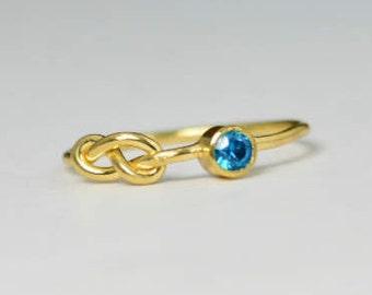 14k Blue Zircon Infinity Ring, 14k Gold Ring, Stackable Rings, Mother's Ring, December Birthstone Ring, Gold Infinity Ring, Gold Knot Ring