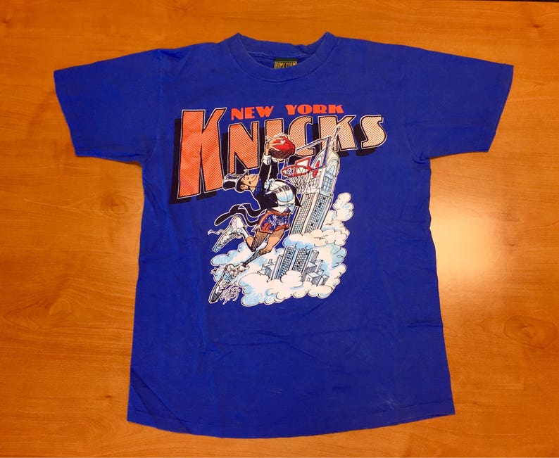 b21080f56d630a Vintage 1990s New York Knicks T-Shirt tee jersey hat mark