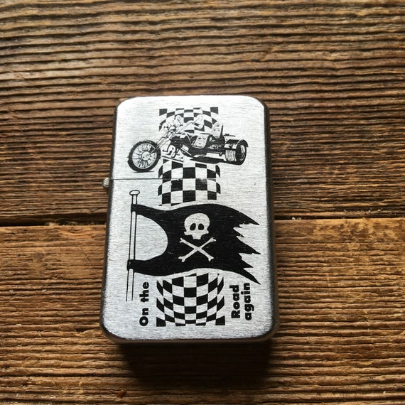 Deadstock tristar petrol lighter with trike decal on thefront