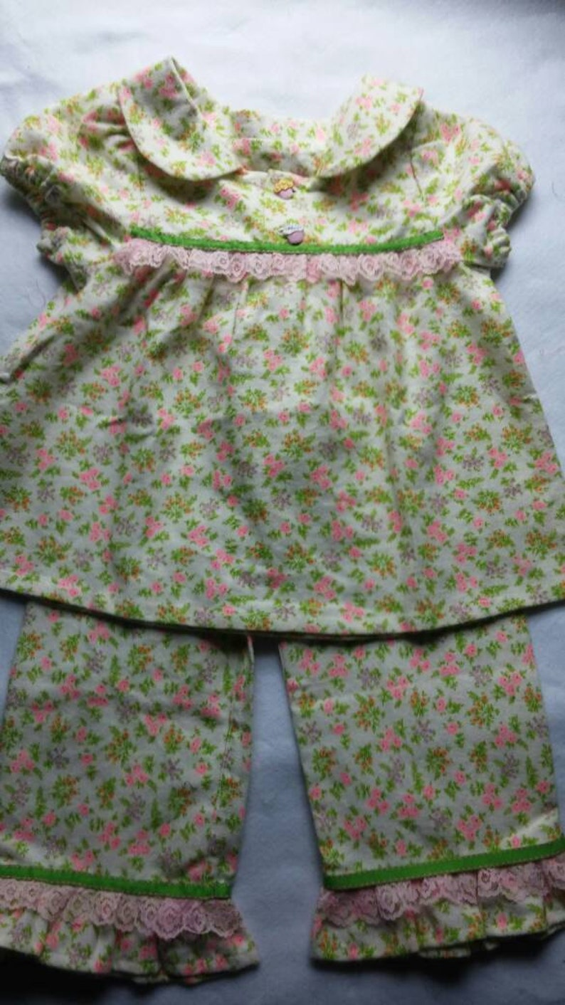 Warm and cozy pink purple orange and green flowered pajama top and bottoms.