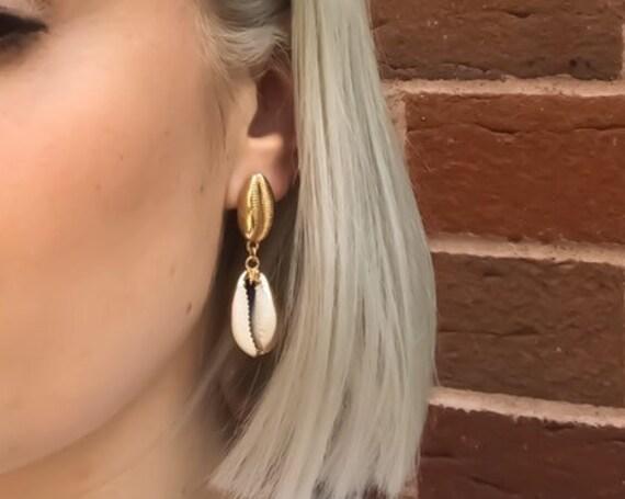 Gold cowri shell drop earrings