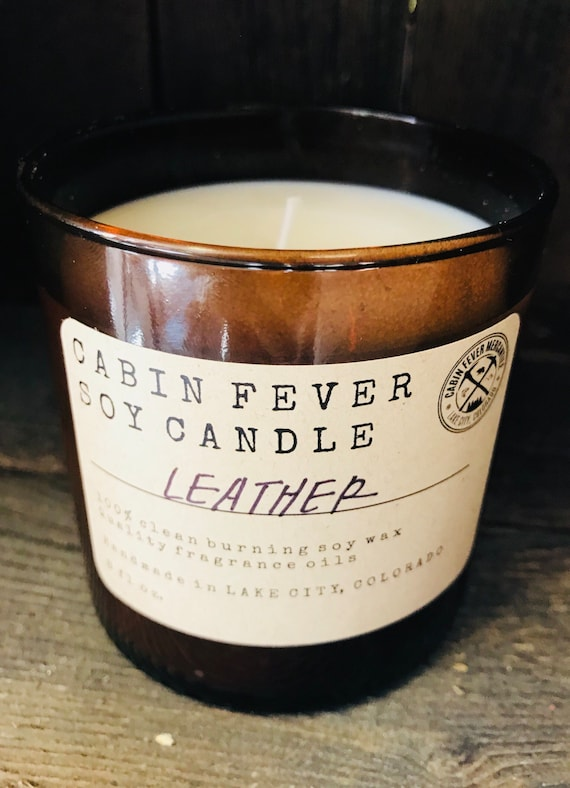 Soy candle / Leather / Real leather / Cowboy / Hand poured / Amber glass / Scented candles / Rustic Candles / Mountain life / Ranch / Cabin