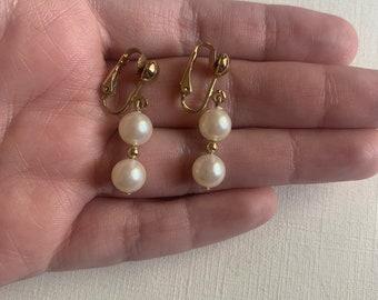 Avon teardrop earrings with enclosed pearl