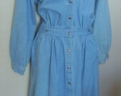 Vintage faded blue 80 39 s -90 39 s denim dress.The dress has a shirt style motif with a 13 button front closure. Long sleeves, gathered at waist.