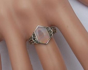Vintage Art Deco Silver Ring with a fine cut Rose Quartz gem.       Unique design.