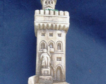 bottle decanter vintage, souvenir San Marino Italy, bottle contains almond amaretto, bottle-shaped castle San Marino