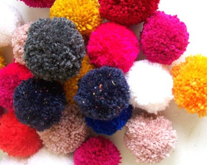 pom poms mixed colours pack of 23 6cm wide pinks blues whites yellows