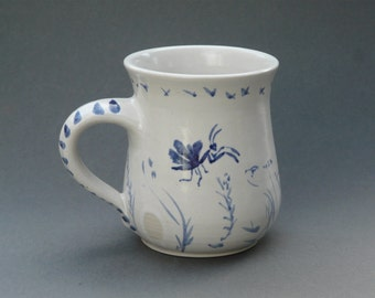 mantis and dragonfly, garden scene mug.