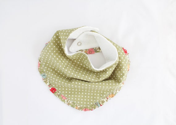Cotton spot with floral frill bandanna bib lined with terry towelling