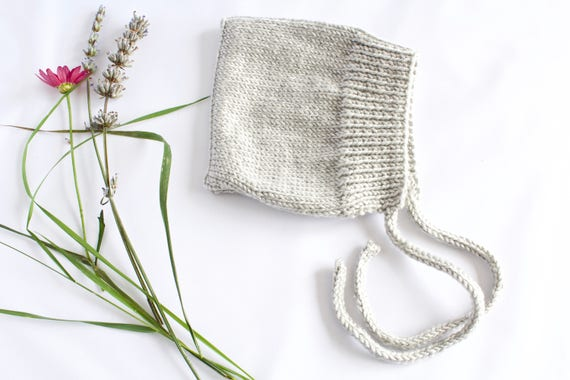 Grey Hand Knitted Baby Bonnet.