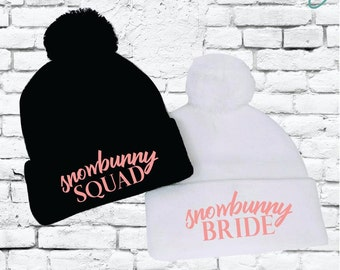 Snowbunny Bride and Squad Pom Pom Beanies Knit Hats Bridal or Bachlorette  Party Pom Pom Beanies Knit Party Hats Funny Ski Winter Hats 0d71c8f7fb01