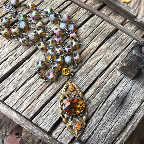 1930s amber cut glass and amber rainbow bead laval