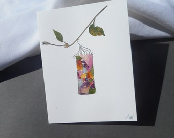 """A """"Happy Birthday !""""  card with real pressed flowers.  A Lantern Ornament.  No message."""