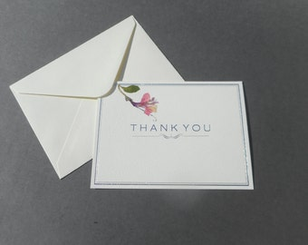 Six stationery Thank You cards with handpressed flowers outside.  Blank inside.