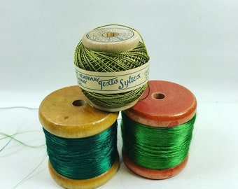 Vintage wooden spools of green thread