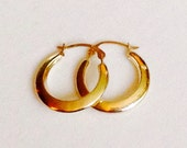 Vintage 14k Yellow Gold Designer Tapered Hoop Earrings Featuring Modern Hollow Finish