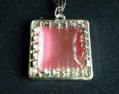 Vintage Rose Colored Opalescent Polished Rhinestone Pendant With Silver Tone Necklace Featuring Clear Rhinestone Accents