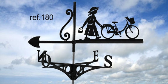 Weathervane with roof girl and her bicycle