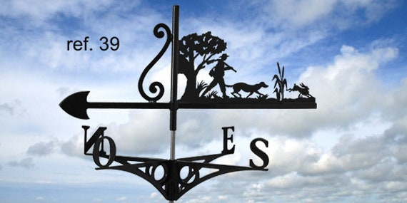 Weathervane with roof hunting hares