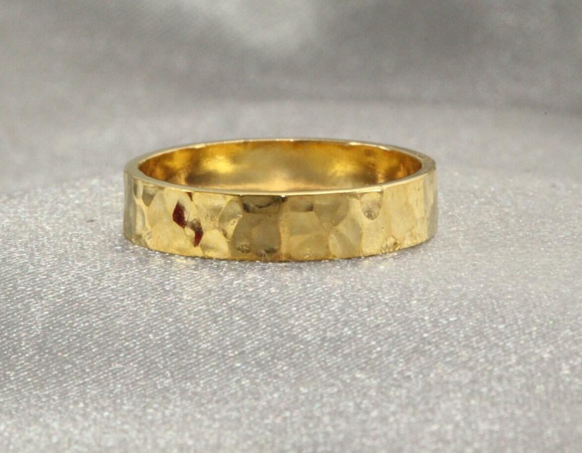 Navajo wedding rings by erick begay