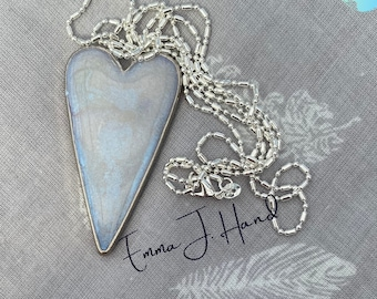 Shiny iridescent blue coloured resin heart on 80cm chain with Free regular shipping