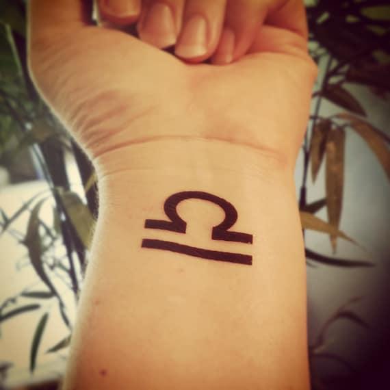 Libra tattoo 4