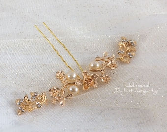 Bridal hair accessories for wedding. Hairpin in the color gold