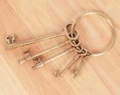 Key set held together with a brass ring holder Vintage solid brass 5 keys